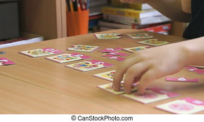 Preschool girl collecting a pattern using puzzles - ...