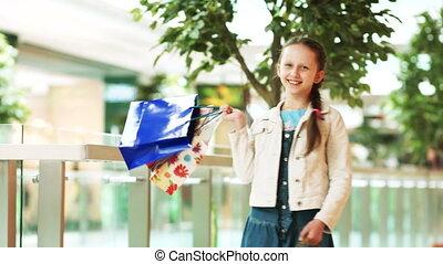 Preschool girl with shopping lookin