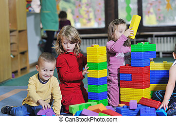 preschool kids - happy child kids group have fun and play at...