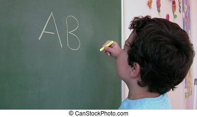 Preschool Student learning  alphabet