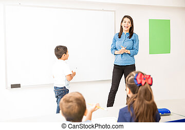 Preschool student participating in class