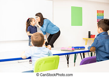 Preschool teacher playing a game in class