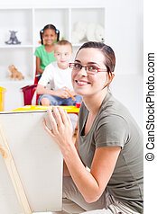 preschool teacher teaching class - beautiful young preschool...