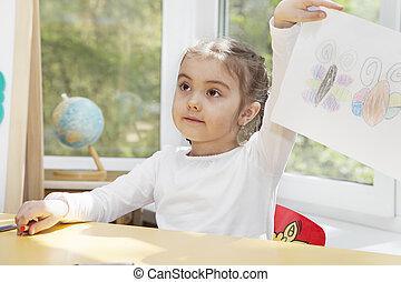 Preschooler girl in the nursery
