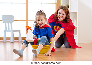 Preschooler kid girl and her mother playing while doing cleanup at home