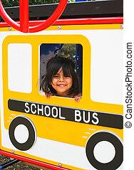 Preschooler on playground bus
