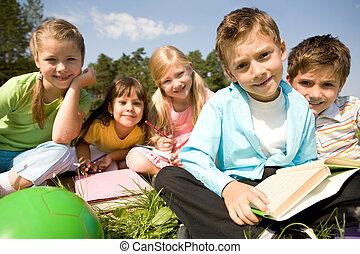 Preschooler - Portrait of smart preschooler holding book...