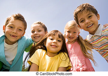 Preschoolers - Portrait of smart preschoolers embracing each...