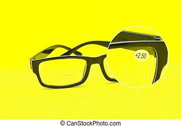prescription black eyeglasses on yellow background