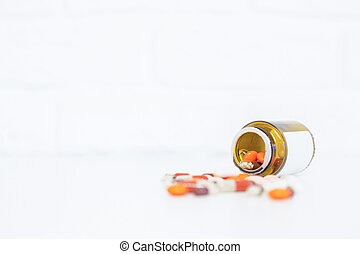 Prescription bottle with pills - Closeup of bright tabletop...
