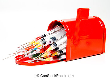Prescription Mail Order - A group of medical syringes in a...