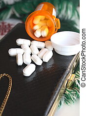 Prescription pills and purse - Open bottle of prescription...