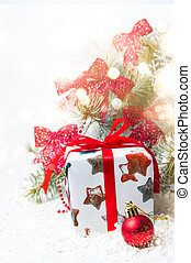 Present box in front of a Christmas tree