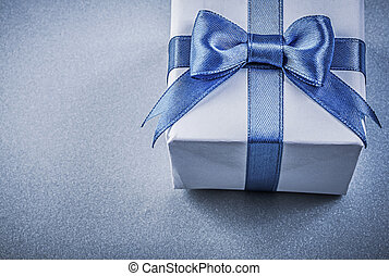 Present box on blue background close up view