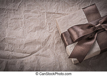 Present box on wrapping paper holidays concept.