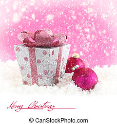Present box with Christmas balls and snow