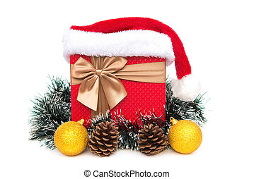 present box with christmas decoration and santa claus hat on a white background