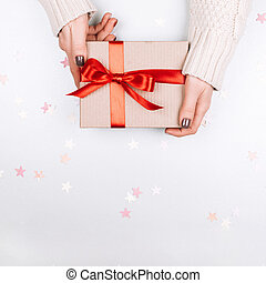 Present box with red bow on white background