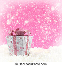 Present box with snow and pink background