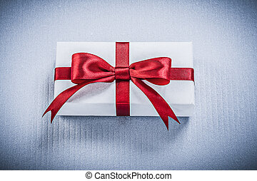 Present box with tied bow on white background holidays concept
