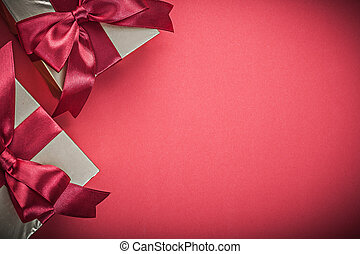 Present boxes on red background close up view holidays concept