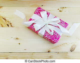present boxes on wooden background close up view holidays concept