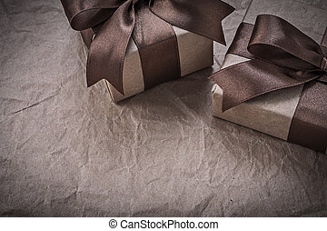 Present boxes with bow on wrapping paper celebrations concept