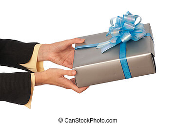 woman giving a silver box with blue bow as a gift for birthday