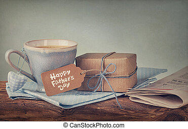 Present for Fathers day - Gift box with a tag and a cup of ...