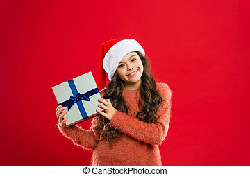 Present for Xmas. Childhood. Happy winter holidays. Small girl. New year party. Are you ready. Santa claus kid. Christmas shopping. Little girl child in santa red hat. New year new goals