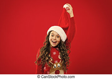 Present for Xmas. Childhood. Happy winter holidays. Small girl. New year party. Santa claus kid. Christmas shopping. Little girl child in santa red hat. Are you ready