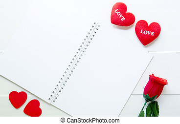 Present gift with red rose flower and heart shape and notebook on wooden table, 14 February of love day with romantic, copy space with note or diary writing text for you, valentine holiday concept, top view.