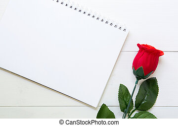 Present gift with red rose flower and notebook on wooden table, 14 February of love day with romantic, copy space with note or diary writing text for you, valentine holiday concept, top view.