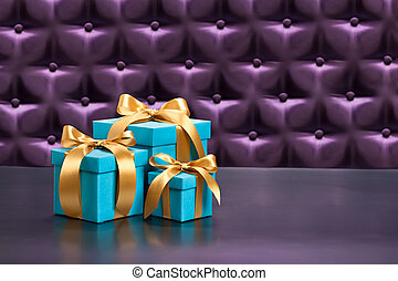 Present in front of a button tufted background - Present in...
