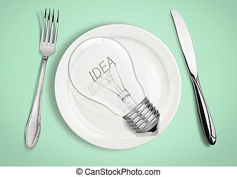 Present new idea concept. Light bulb on plate with fork and spoon.