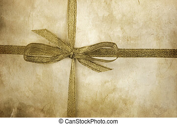 present - old  grunge paper texture and golden ribbon