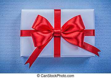 Present on blue background close up view holidays concept