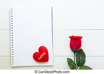 Present red rose flower and notebook and heart shape with copy space on wooden table, 14 February of love day with romantic, valentine holiday concept.