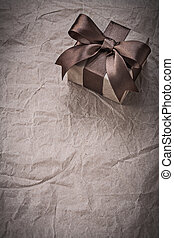 Present with bow on wrapping paper copyspace holidays concept
