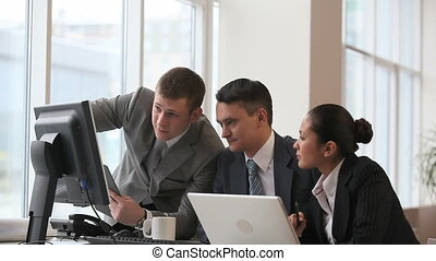 Presentation - Businesspeople discussing computer work