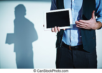 Presentation - Male employee pointing at touchscreen