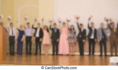 Presentation of diploma to students at a gymnasium -...