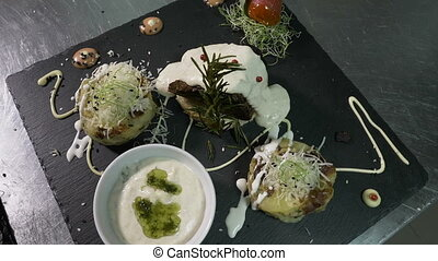 Presentation of exotic and flavored dish with white sauce...