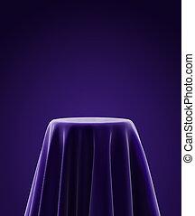 presentation pedestal covered with purple silk cloth