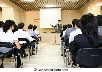 Presentation - Image of confident businessman explaining...