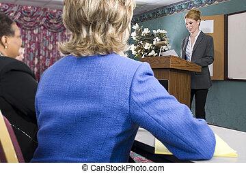 Presentation - Young Hispanic woman giving presentation at...