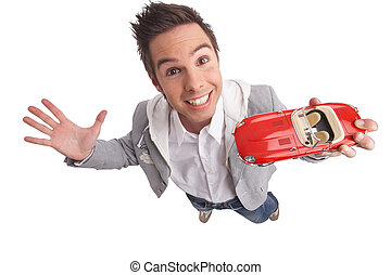 young man presenting a miniature car with clipping path included