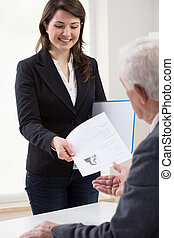 Presenting curriculum vitae - Young smiling woman presenting...