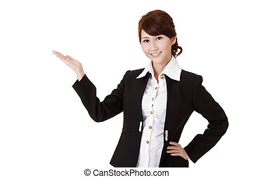 Presenting gesture on smiling business woman, half length closeup portrait on white background.