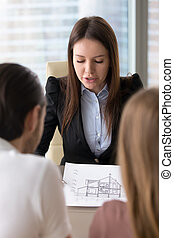Presenting house plan, building project on meeting with clients